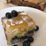 Blueberry square with passion fruit syrup